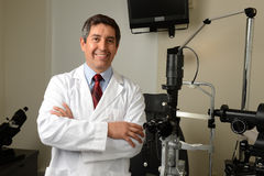 Eye Doctor in his office with istruments Stock Images
