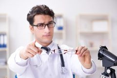 The eye doctor in medical concept. Eye doctor in medical concept Royalty Free Stock Photos
