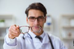 The eye doctor in medical concept. Eye doctor in medical concept royalty free stock image