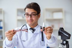 The eye doctor in medical concept. Eye doctor in medical concept royalty free stock photography