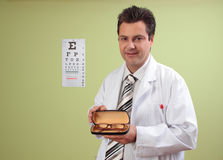 Eye doctor recommends eyeglasses Royalty Free Stock Image