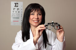 Eye doctor with trial frames. An eye doctor holding a pair of eye test trial  frames Royalty Free Stock Photography