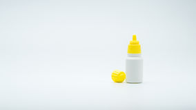 Eye drops bottle with open yellow cap isolated on white background with blank label and copy space. Just add your own text royalty free stock images