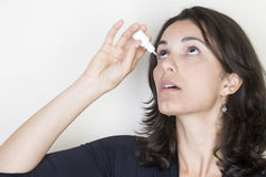 Eye drops woman Royalty Free Stock Images