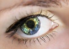 Eye with earth. Earth in woman's eye (shallow DoF Stock Photo