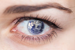 Eye and the Earth. Royalty Free Stock Photos