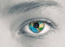Eye with Earth planet Stock Photography