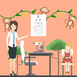 Eye exam for children. Eye exam for children with doctor and girl in ophtalmologist`s office with decoration. Preparing for school. Healthcare for children Royalty Free Stock Photography