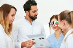 Eye Exam. Doctors Checking Woman Eyesight With Optometry Glasses stock photography