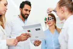 Eye Exam. Doctors Checking Woman Eyesight With Optometry Glasses stock photo