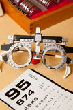 Eye exam glasses and chart. Eye exam glasses with extra lenses and eye chart stock photo