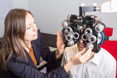 Eye exam. Man during an eye exam stock photography