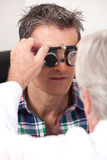 Eye Exam with Measuring Spectacles Stock Images