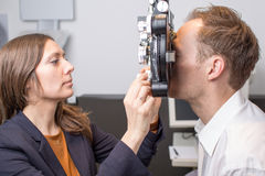 Eye exam at optician Stock Photo