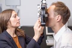 Eye exam at optician Stock Photo
