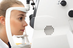 An eye exam, the patient in ophthalmology clinic. The patient in ophthalmology clinic during the study of computer vision defects Royalty Free Stock Photo