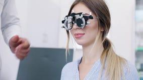 Eye Exam. Woman In Glasses Checking Eyesight At Clinic