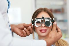 Eye Exam. Woman In Glasses Checking Eyesight At Clinic. Ophthalmology Examination. High Resolution stock image