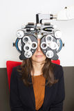 Eye exam. Woman during an eye exam with thumb up Stock Photo