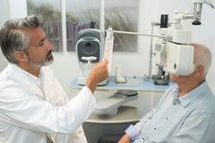 Free Eye Examination At Slit Lamp Stock Images - 103621684