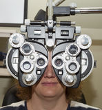 Eye examination with a phoropter Royalty Free Stock Photography