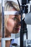 Eye examination on slit lamp Stock Image