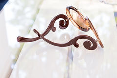 Eye fashioned glasses on glass table Stock Image