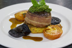 Eye fillet steak wrapped in bacon Stock Images