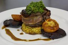 Eye fillet steak wrapped in bacon Stock Photography