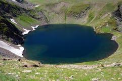 The Eye Glacial Lake. Aerial view of the Okoto (Eye) glacial lake in the Rila National Park in Bulgaria royalty free stock photos
