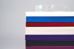 Eye glass on books Royalty Free Stock Photography