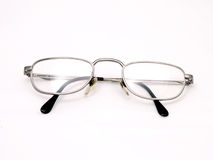 Eye Glasses. A pair of mans eye glasses Isolated over white stock images