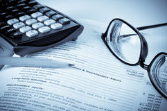 Eye glasses on an accounting book Royalty Free Stock Photos