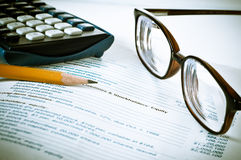 Eye glasses on an accounting book Royalty Free Stock Photo