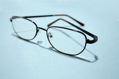 Eye glasses on blue Royalty Free Stock Photography