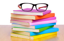 Eye glasses on book stack Stock Image