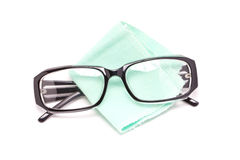 Eye Glasses With Cleaning Cloth. Eye glasses with cleaning cloth isolated on white background Stock Photos