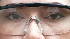 Eye with glasses stock footage
