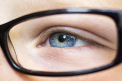 Eye in glasses close up. Kids eye in glasses close up Stock Photo
