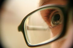 Eye with glasses closeup Royalty Free Stock Image