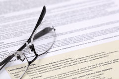 Eye glasses and document. Close up Royalty Free Stock Photography