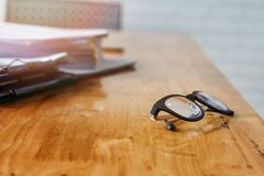 Eye glasses and documents on office desk.  stock images
