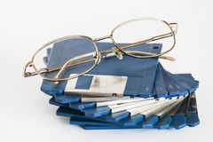 Eye glasses on floppy disks. Eyeglasses are laying on a stack of floppy disks Stock Image