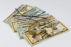 Eye glasses gold pocket watch cash Stock Photography