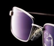 Eye glasses isolated on black. Background stock photo