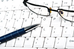 Eye glasses on keyboard Royalty Free Stock Images
