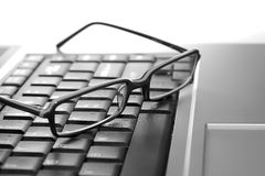Eye glasses on laptop Royalty Free Stock Photos