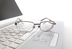Eye glasses on a laptop keyboard Royalty Free Stock Photography