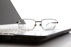Eye glasses on a laptop keyboard Stock Photos