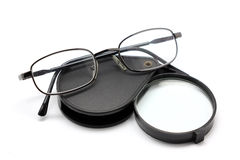 Eye glasses and magnifying glass isolated on white Royalty Free Stock Photos